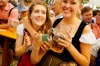 Revelers enjoy drinking beer at Hofbraeuhaus beer tent on the opening day of the 2015 Oktoberfest in Munich, Germany.