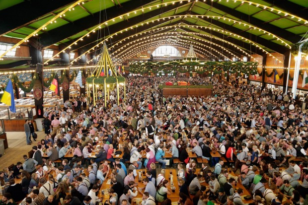 People sit in the Augustiner beer tent during the opening day of the 2015 Oktoberfest in Munich, Germany. The 182nd ...