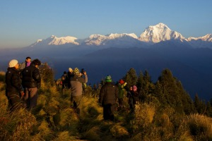 Tourists and trekkers enjoy view at dawn looking to Dhaulagiri from Poon Hill, Annapurna Region, Himalayas, Nepal, Asia.