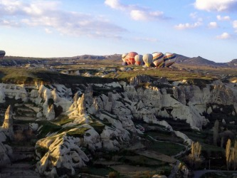 At six and again at eight every morning near Goreme, Cappadocia, central Turkey, up to 100 hot air balloons take to the ...