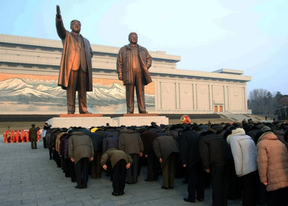 Crowds bow to the statues of North Korea's late leader Kim Jong Il, right,  and his father, North Korea's founder Kim Il ...