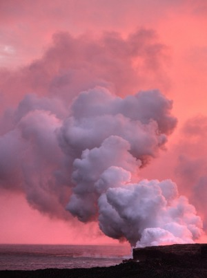 Steam from the lava flow of Kilauea flowing into the ocean at sunset on the Big Island of Hawaii.