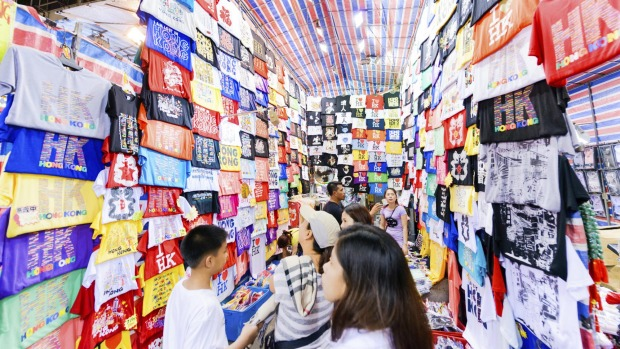 You'll find cheap knock-offs and souvenirs in the buzz at the Temple Street Night Market.