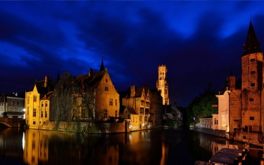 The beautiful historic UNESCO World Heritage listed town of Brugge (also spelled Bruges) in Belgium takes on a completely different character in the evening. The hordes of tourists that have been bussed in for the day leave, and the canals, bridges and medieval buildings are strategically lit up. For me, this photograph typifies Brugge and takes me back there in an instant. It also happens to be the location where Colin Farrell's character leapt into the canal in the movie In Bruges.