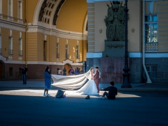 We had a short wait outside the magnificent Hermitage Museum in St. Petersburg. Through the arch in the extremely large courtyard walked the bride, and I caught her being photographed. The image of the groom in trainers, the sunlight through the veil, and the tourists wandering behind them, is a memory not soon forgotten.