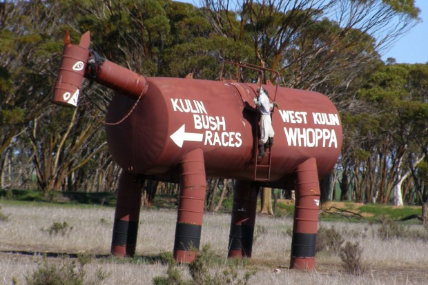 Tin Horse Highway. No missing this sign pointing the way to the racecourse near the wheatfields town of Kulin in ...