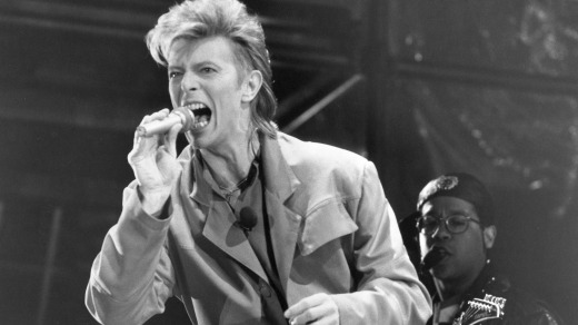 David Bowie performing during a concert at the Reichstag.