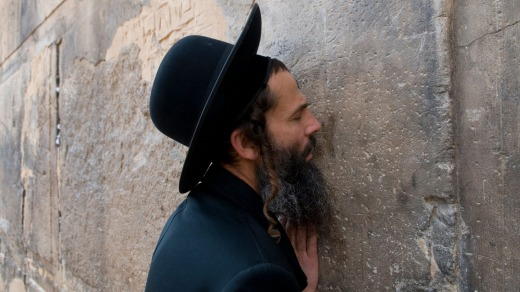 An ultra orthodox Jewish man at prayer outside Cave of Machpela in Hebron.