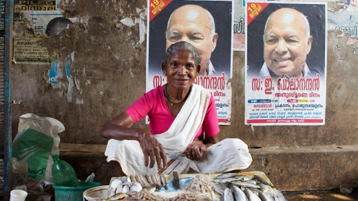 Keralite woman selling fresh fish in Fort Cochin market, Kerala.