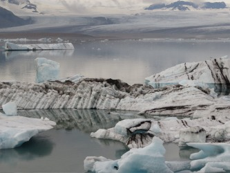 Icelandic Wonderland. The Jokulsarlon glacier lagoon is breathtakingly beautiful. Icebergs of all shapes and sizes float ...