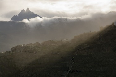 This was taken in Ollantaytambo, Peru in April 2015. After a few days of exploring the Sacred Valley, the anticipation of Machu Picchu reaches a crescendo, just walking around the ancient Inca village of Ollantaytambo and suddenly a majestic mountain appear in the clouds which looks like Machu Picchu. Just imagining the Inca ruler, at that moment deciding that he would to have his summer retreat up there.