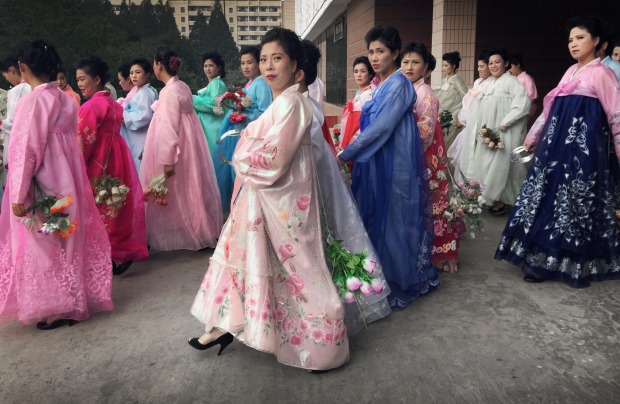 North Korean women wearing traditional dresses gather for rehearsals in Pyongyang, North Korea in preparation for the ...