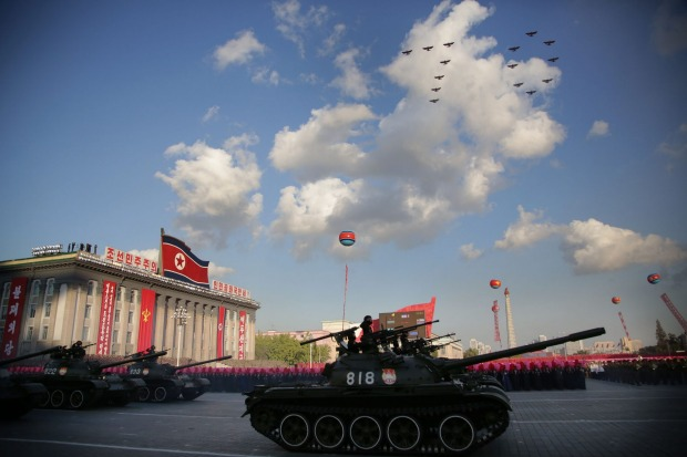 North Korean soldiers parade through Kim Il Sung Square with their missiles and rockets as jets fly in formation during ...
