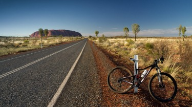 I finally bought my ticket and travelled to the red centre of Australia to see the big rock in person. While the masses took the tourist buses I took my two wheels and journeyed to the centre of the Oz. I snapped this photo in the early morning before the searing heat caught me out and left my drink bottle dry.