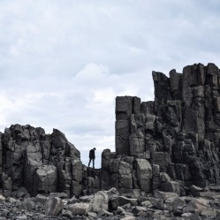 A stormy afternoon in Bombo quarry, with cloud-filtered light accentuating the cracks and crevices of an undeniably ...