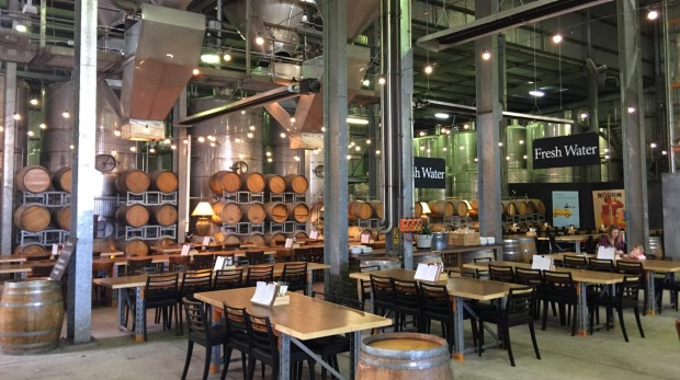 At Mt Duneed Estate, the Barrel Hall dining area is an impressive lofty industrial space, with huge steel vats suspended ...