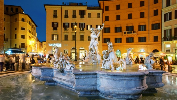 Piazza Navona's fountain at night, one of the countless delights of Rome.