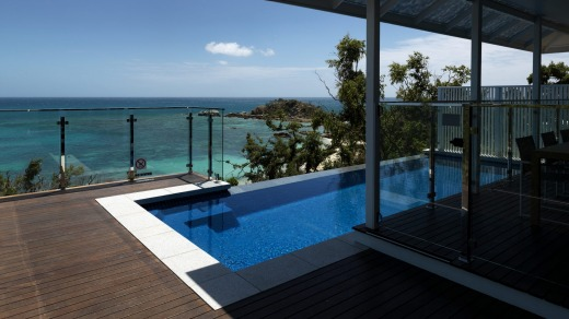 The Villa sits on a ridge and has uninterrupted views across Sunset Beach and the Coral Sea.