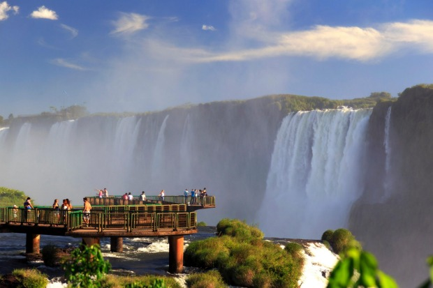 TAKE IT BY THE THROAT: One of the world's biggest falls - actually there's 275 of them - the mighty Iguazu Falls lies ...