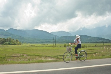 Bikes are a typical mode of transport in Vietnam and as we traveled between towns this lady in her traditional black ...
