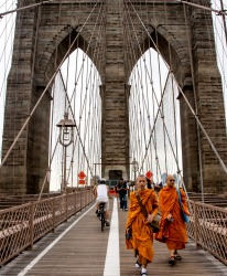 Brooklyn Bridge, New York City. Monks armed with cameras taking in the sites across the Bridge.