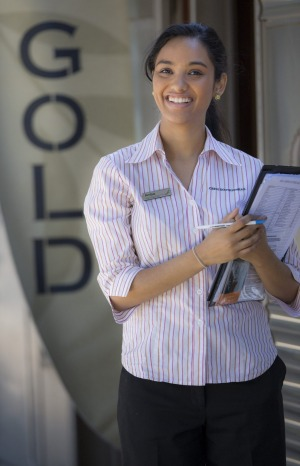 An Indian Pacific 'hospitality assistant' waits to greet guests of the train's Gold Class.  Photo: supplied