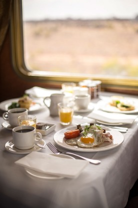 Breakfast is served in the Queen Adelaide restaurant dining carriage on the Indian Pacific train between Sydney and Perth.
