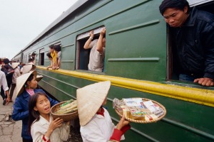 On the move: Vendors offer their wares to passengers at Nha Trang station, Vietnam.