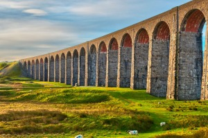 Pen-y-ghent and Ribblehead Viaduct on Settle to Carlisle Railway, Yorkshire Dales National Park.