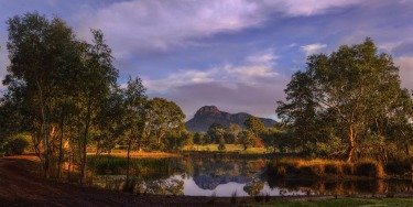 Mount Sturgeon in the Grampians Victoria reflected on a still morning from a small park at Dunkeld.
