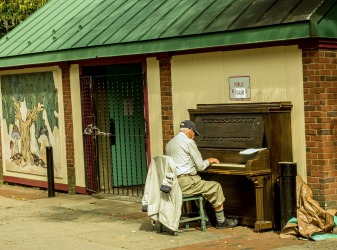 "While spending a few days in Boston I took the train to salem for the day, on 28 Sep 2015. I loved this public piano. I'm assuming the sign originally said ""Public Restroom"". This man could really play the piano."