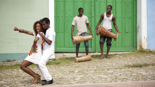 Young black couple dancing salsa in Trinidad, Cuba.