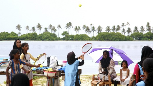 Girls playing the Maldivian game of basi.