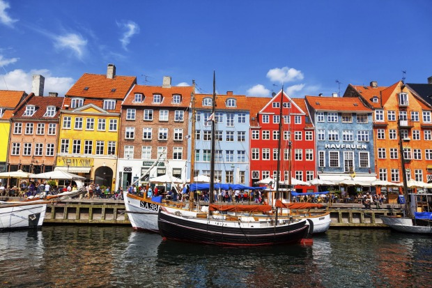 "Nyhavn, Copenhagen, Denmark: The 300-year-old, village-like ""New Harbour"" of restored half-timber houses retains a ..."