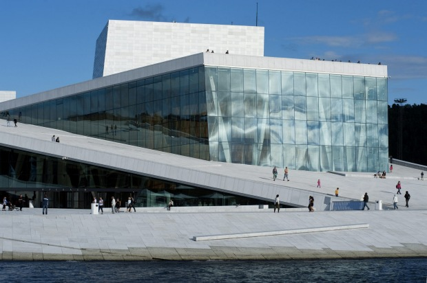 One of the best waterfront buildings: The Opera House, Oslo, Norway.Pitched courtyards in white granite and marble rise ...
