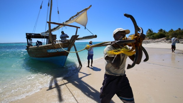 The dhow anchors on Mogundula Island's beach, in the Quirimbas Archipelago, Mozambique.