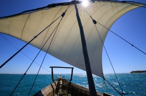 The dhow's sail full of breeze.