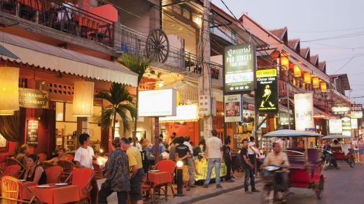 Restaurants on Pub Street, Siem Reap, offer a welcome cheap meal and cold beer after a day's cycling.