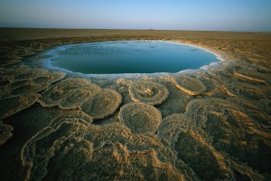 Discs of travertine ring a twelve-foot wide hot spring in the Danakil Depression, Ethiopia.