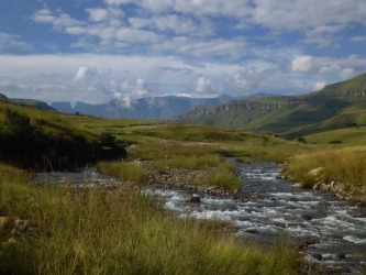 A beautiful stream meandering through the Drakensberg Mountains in South Africa. Earlier in the day we saw the local women washing their brightly coloured clothes in the stream.
