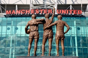 Bronze statues of Manchester United Legends Sir Bobby Charlton, Denis Law and George Best at Old Trafford.