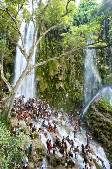 SAUT D'EAU VOODOO FESTIVAL, HAITI: Each July, swarms of Haitians trek down a series of treacherous dirt tracks to gather ...
