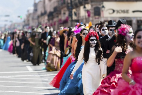 MORELIA, MEXICO - NOVEMBER 01: Young couples, costumed as ??La Catrina??, a Mexican pop culture icon representing the ...