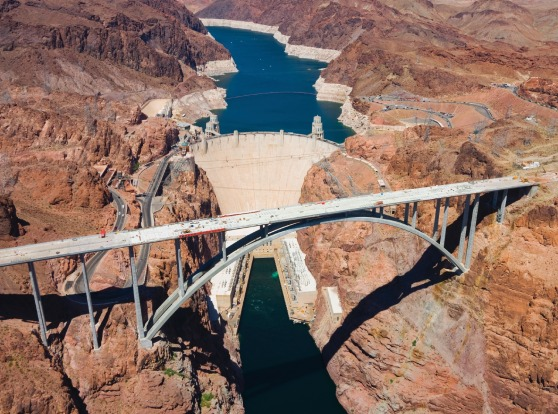 Hoover Dam: To fly over the Hoover Dam is to understand in one dizzying snapshot the power humans have to alter their ...