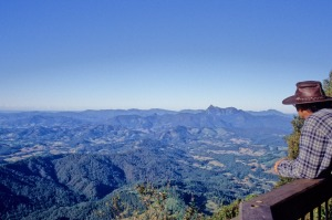 A tourist looks out from the Best of All Lookout in Springbrook National Park.