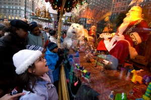 A child admires the Christmas window display at Macy's department store in midtown Manhattan.