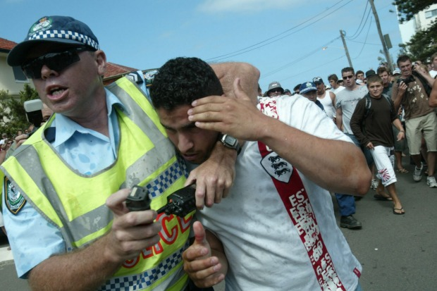 A police officer rescues a  man at North Cronulla.
