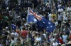 """Then police commissioner Ken Moroney said the rioters - many of them carrying the national flag - were """"clearly ..."""