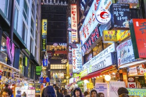 The Myeong-Dong district at night. The location is the premiere district for shopping in the city.