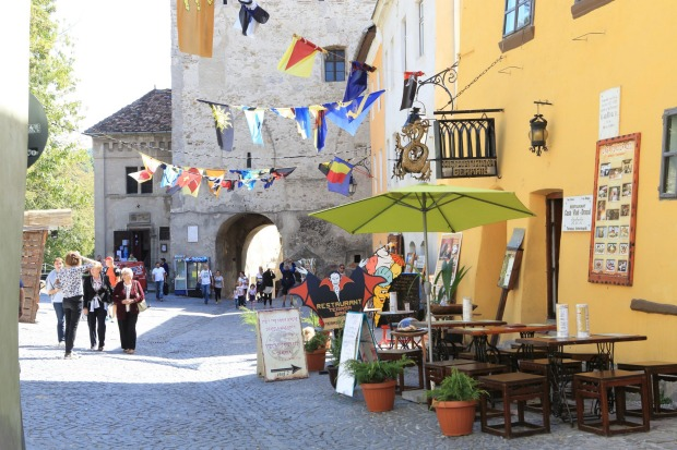 The main street leading up to the Clock Tower, in Sighisoara, the medieval, fortified town, in Transylvania, Romania.